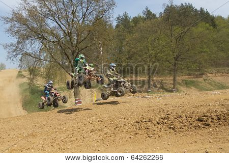 Trinity Of Quad Riders Jumping