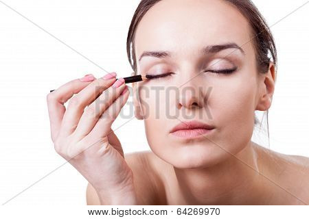 Woman Using An Eyeliner