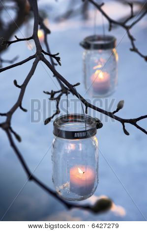Bare Branches With Sparkling Votives In Homespun Holders
