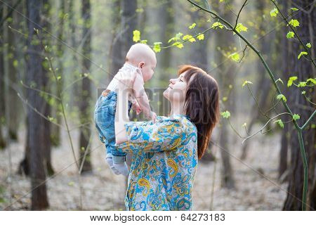 Young Mother With Her Son In A Spring Forest