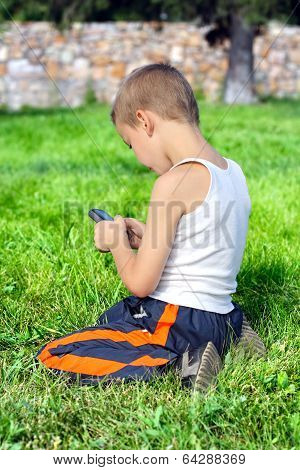 Kid With Mobile Phone