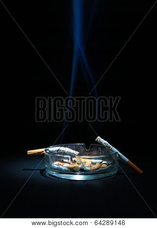 Ashtray And Two Cigarette