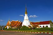 pic of chums  - Idyllic Wat Pra That Choeng Chum Worawihal temple with blue sky Sakon Nakhon Province northeastern of Thailand - JPG
