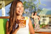 stock photo of hawaiian girl  - Woman drinking alcohol Mai Tai drink on Hawaii at beach club at sunset - JPG