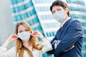 picture of swine flu  - Junior executives dynamics wearing protective face mask against pollution - JPG