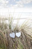 stock photo of blue things  - two blue wooden love heart in dunes on an Irish beach in summer - JPG