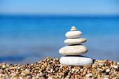 pic of freedom tower  - Stack of pebble stones at the beach - JPG