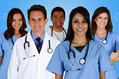 stock photo of nursing  - Group of doctors and nurses set in a hospital - JPG