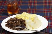 picture of haggis  - Haggis turnips mashed potatoes and a glass of whisky on a tartan background  - JPG