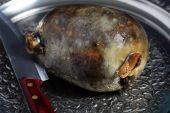 stock photo of haggis  - A cooked haggis on an ornate metal tray such as might be used for a Burns - JPG
