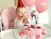 stock photo of solemn  - one-year-old little girl solemnize birthday happy laughter horizontal photo