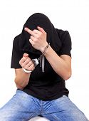stock photo of indecent  - Man in Handcuffs shows Middle Finger Isolated on the White Background - JPG