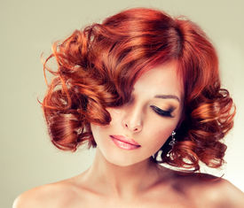 stock photo of hair comb  - Beautiful model with red curly hair  - JPG