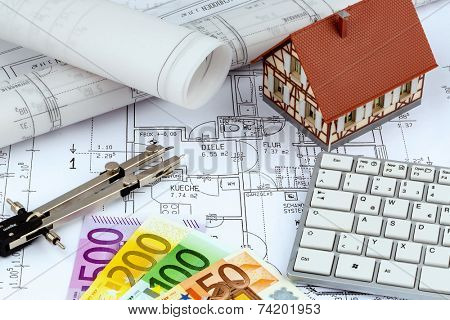 an architect's blueprint with euro money. symbol photo for financing and planning of a new home.