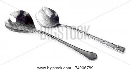 Pair of spoons isolated on white