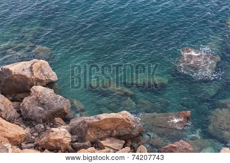 Wave Water Of Sea Near Rock Stone Photo.