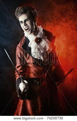 Handsome bloodthirsty vampire. Halloween. Dracula costume.