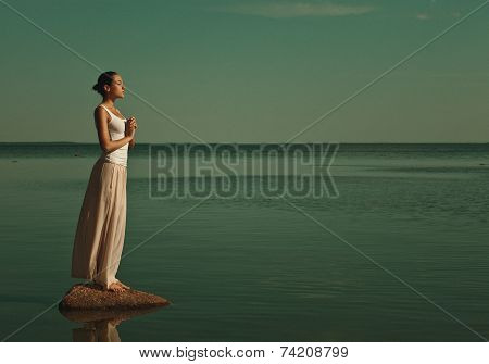 woman meditating in a yoga pose