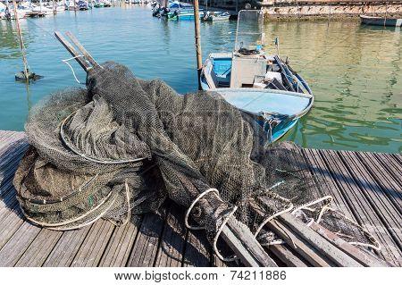 Fishing Nets, Creels And Fishing Boats
