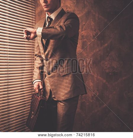 Well-dressed businessman looking at his watch
