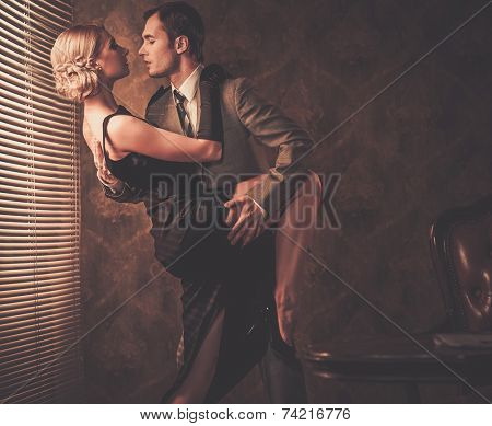 Couple in retro interior near a window
