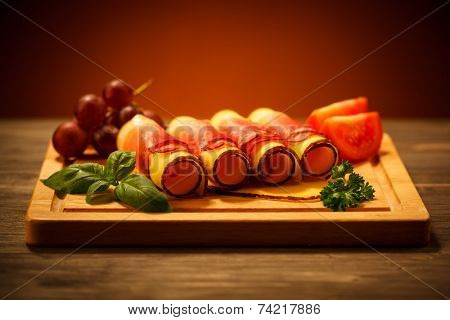 Cheese and ham on cutting board