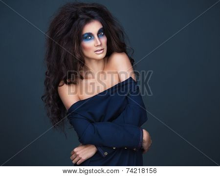 Portrait Of A Young Girl With A Fashion Dark  Makeup Of Eyes And And Bulk Hair