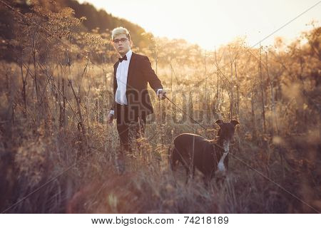 Young Attractive Man In Suit And Tie With A Greyhound Dog In Autumn Outdoors