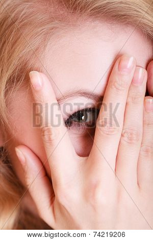 Shy Afraid Woman Peeking Through Her Fingers