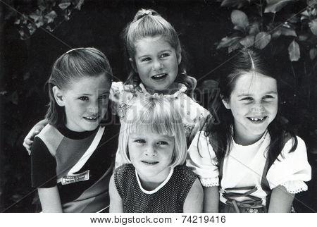 USA- CIRCA 1950s: Vintage photo shows smiling girls.