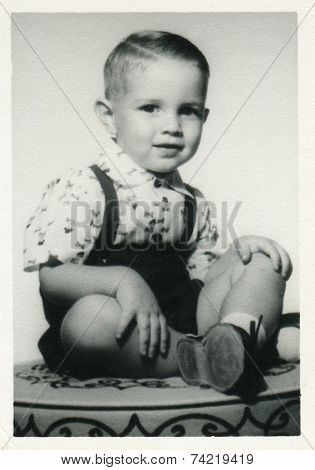 USA- CIRCA 1960s: Vintage photo shows portret of little boy in shorts.