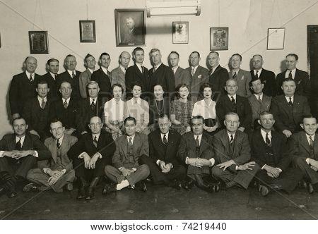 USA- CIRCA 1950s: Vintage photo shows group portrait offfice staff.