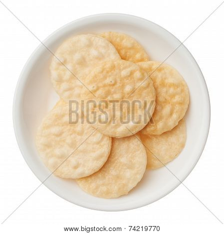 Rice Crackers In A Bowl Isolated On White Background
