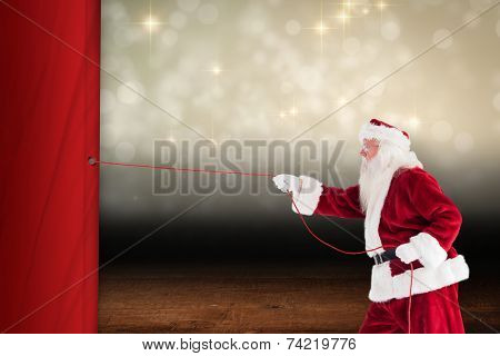 Santa pulls something with a rope against shimmering light design over boards
