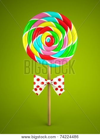 Rainbow lollipop with bow on green background