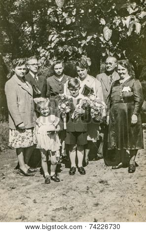 POLAND, CIRCA FIFTIES: Vintage photo of big family with children at First Communion of little boy