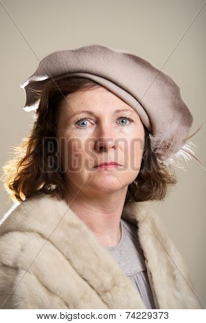 Brunette In Taupe Hat And Fur Stole