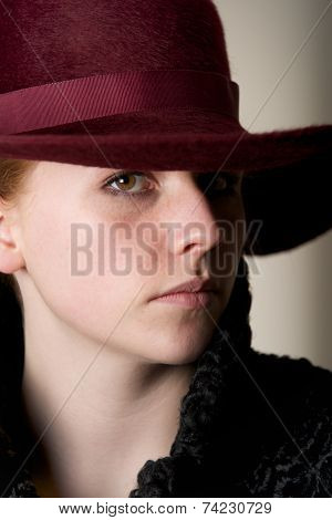 Close-up Of Redhead In Ribboned Maroon Hat