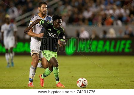 CARSON, CA - OCT 19: Obafemi Martins & Omar Gonzalez (L) during the Los Angeles Galaxy MLS game against the Seattle Sounders on October 19th 2014 at the StubHub Center.