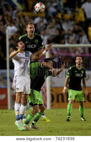 CARSON, CA - OCT 19: Chad Marshall, Gonzalo Pineda, & Alan Gordon fight for the ball during the Los Angeles Galaxy MLS game against the Seattle Sounders on October 19th 2014 at the StubHub Center.