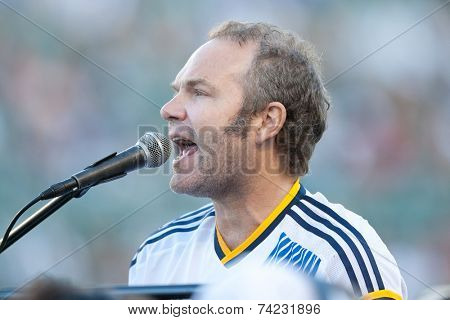 CARSON, CA - OCT 19: John Ondrasik AKA Five For Fighting performs before the Los Angeles Galaxy MLS game against the Seattle Sounders on October 19th 2014 at the StubHub Center.