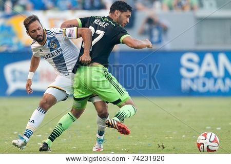 CARSON, CA - OCT 19: Marcelo Sarvas & Lamar Neagle (R) fight for the ball during the Los Angeles Galaxy MLS game against the Seattle Sounders on October 19th 2014 at the StubHub Center.