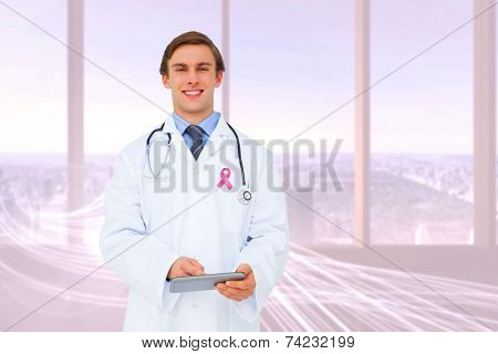 Young doctor using tablet pc against abstract white line design in room