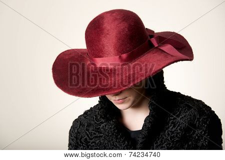 Redhead With Face Hidden By Maroon Hat