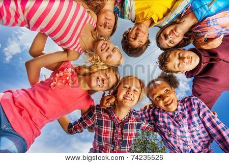 Bottom view of kids group standing in round shape