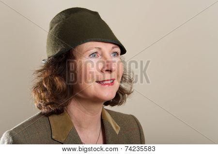 Smiling Brunette In Tweed Jacket And Hat