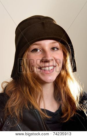 Smiling Redhead In Cloche Hat And Jacket