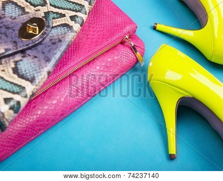 Neon high heels, dress and snakeskin print bag, woman fashion concept
