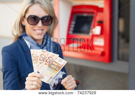 Young woman showing money
