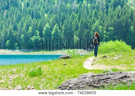 Traveler in front of lake view and mountains